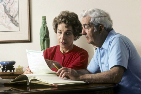 Retired Couple Checking on Financial Records